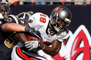 TAMPA, FL - OCTOBER 24:  Defenders Kevin Dockery #35 and James Laurinaitis #55 of the St. Louis Rams bring down receiver Mike Williams #19 of the Tampa Bay Buccaneers during the game at Raymond James Stadium on October 24, 2010 in Tampa, Florida.  (Photo