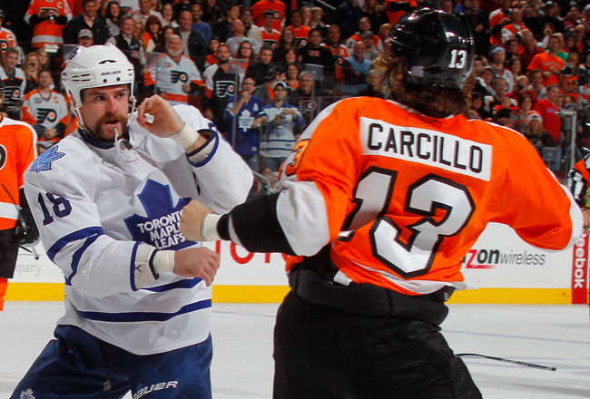 PHILADELPHIA - OCTOBER 23: Mike Brown #18 of the Toronto Maple Leafs fights with Daniel Carcillo #13 of the Philadelphia Flyers in the first period of a hockey game at the Wells Fargo Center on October 23, 2010 in Philadelphia, Pennsylvania.  (Photo by Pa
