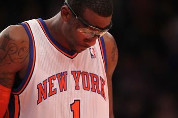 NEW YORK - OCTOBER 30:  Amar'e Stoudemire #1 of the New York Knicks watches a foul shot against the Portland Trail Blazers at Madison Square Garden on October 30, 2010 in New York City. NOTE TO USER: User expressly acknowledges and agrees that, by downloa