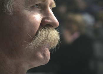 TORONTO - NOVEMBER 12:  Lanny McDonald of Team Canada, sporting his famous mustache, pauses during introductions prior to his game against Team World during the Hockey Hall of Fame Legends Classic game at the Air Canada Centre November 12, 2006 in Toronto