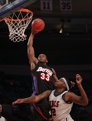 NEW YORK - MARCH 30: Chris Wright #33 of the Dayton Flyers goes over DeAundre Cranston #52 of Ole Miss during their semi final at Madison Square Garden on March 30, 2010 in New York, New York.  (Photo by Nick Laham/Getty Images)