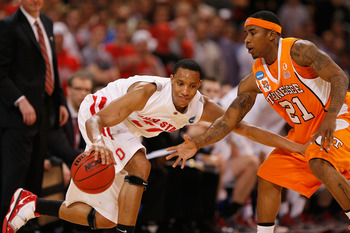 ST. LOUIS - MARCH 26: Evan Turner #21 of the Ohio State  Buckeyes looks to get past Melvin Goins #21 of the Tennessee Volunteers during the midwest regional semifinal of the 2010 NCAA men's basketball tournament at the Edward Jones Dome on March 26, 2010