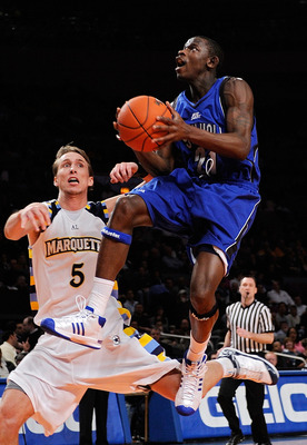 NEW YORK - MARCH 12:  Jeremy Hazell #21 of the Seton Hall Pirates gets the basket and the foul against Dan Fitzgerald #5 of the Marquette Golden Eagles during the 2008 Big East Men's Basketball Championship at Madison Square Garden on March 12, 2008 in Ne