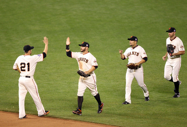 SAN FRANCISCO - OCTOBER 28:  (L-R) Freddy Sanchez #21, Cody Ross #13, Andres Torres #56 and Mike Fontenot #14 of the San Francisco Giants celebrate after the Giants defeated the Texas Rangers 9-0 in Game Two of the 2010 MLB World Series at AT&T Park on Oc