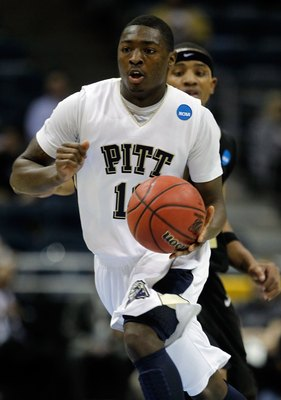 MILWAUKEE - MARCH 19:  Ashton Gibbs #12 of the Pittsburgh Panthers moves the ball while taking on the Oakland Golden Grizzlies during the first round of the 2010 NCAA men's basketball tournament at the Bradley Center on March 19, 2010 in Milwaukee, Wiscon