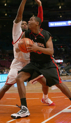 NEW YORK - DECEMBER 09:  Trey Thompkins #33 of the Georgia Bulldogs drives against Sean Evans #5 of the St. John's Red Storm during the SEC Big East Invitational at Madison Square Garden on December 9, 2009 in New York, New York. The Red Storm defeated th
