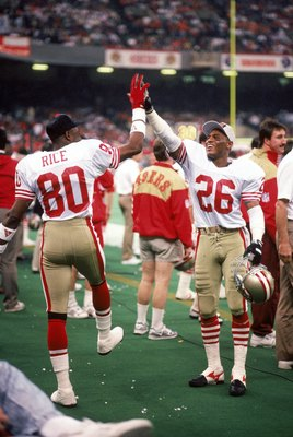 NEW ORLEANS - JANUARY 28:  Wide receiver New York Giants #80 and cornerback Darryl Pollard #26 of the San Francisco 49ers celebrate on the sideline in Super Bowl XXIV against the Denver Broncos at Louisiana Superdome on January 28, 1990 in New Orleans, Lo