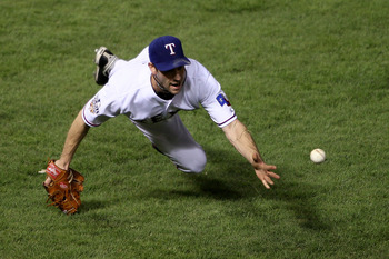 ARLINGTON, TX - NOVEMBER 01:  Cliff Lee #33 of the Texas Rangers tosses over to first for the out after a sac bunt by Aubrey Huff of the San Francisco Giants in Game Five of the 2010 MLB World Series at Rangers Ballpark in Arlington on November 1, 2010 in