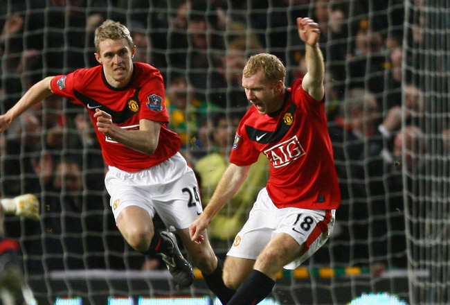 MANCHESTER, ENGLAND - JANUARY 27:  Paul Scholes of Manchester United celebrates scoring the opening goal during the Carling Cup Semi Final second leg match between Manchester United and Manchester City at Old Trafford on January 27, 2010 in Manchester, En