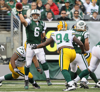 EAST RUTHERFORD, NJ - OCTOBER 31: Mark Sanchez #6 of the New York Jets throws a pass against the Green Bay Packers on October 31, 2010 at the New Meadowlands Stadium in East Rutherford, New Jersey. The Packers defeated the Jets 9-0. (Photo by Jim McIsaac/