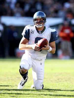 OAKLAND, CA - OCTOBER 31:  Matt Hasselbeck #8 of the Seattle Seahawks gets off the ground after he was sacked by the Oakland Raiders at Oakland-Alameda County Coliseum on October 31, 2010 in Oakland, California.  (Photo by Ezra Shaw/Getty Images)