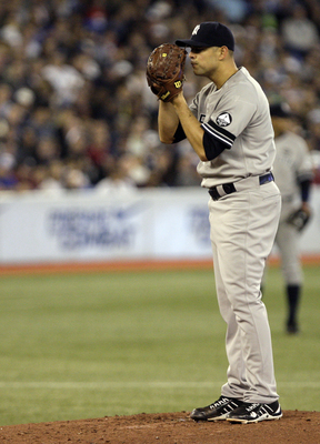 TORONTO, ON - SEPTEMBER 29: Javier Vasquez #31 of the New York Yankees sets up during a MLB game against the Toronto Blue Jays at the Rogers Centre September 29, 2010 in Toronto, Ontario, Canada. (Photo by Abelimages/Getty Images)