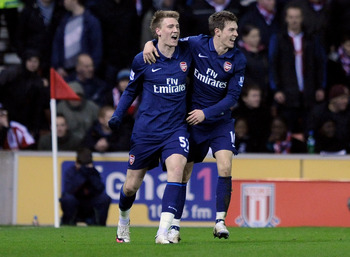 STOKE ON TRENT, ENGLAND - FEBRUARY 27:   Nicklas Bendtner (L) of Arsenal celebrates scoring his team's first goal with team mate Aaron Ramsey during the Barclays Premier League match between Stoke City and Arsenal at The Britannia Stadium on February 27,