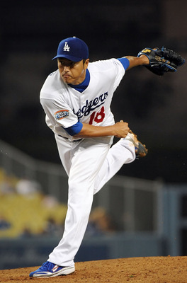 LOS ANGELES, CA - SEPTEMBER 17:  Hiroki Kuroda #18 of the Los Angeles Dodgers pitches against the Colorado Rockies at Dodger Stadium on September 17, 2010 in Los Angeles, California.  (Photo by Lisa Blumenfeld/Getty Images)