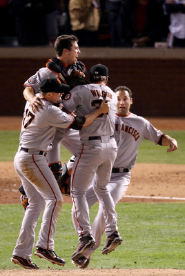 ARLINGTON, TX - NOVEMBER 01:  Buster Posey #28, Brian Wilson #38, Aubrey Huff #17 and Pat Burrell #9 of the San Francisco Giants celebrate defeating the Texas Rangers 3-1 to win the 2010 MLB World Series at Rangers Ballpark in Arlington on November 1, 201