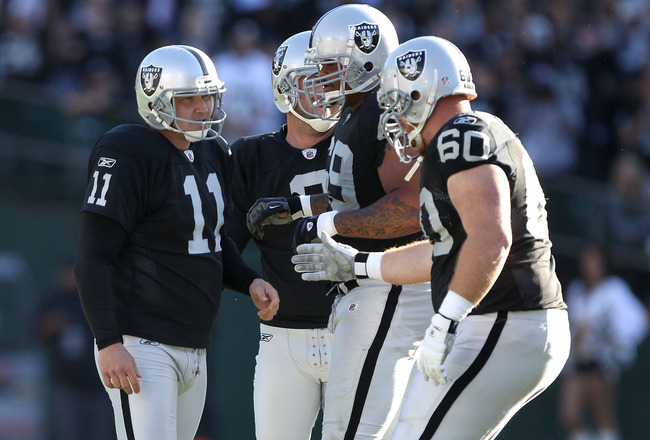 OAKLAND, CA - OCTOBER 31:  Sebastian Janikowski #11 of the Oakland Raiders is congratulated by teammates after he kicked a field goal against the Seattle Seahawks at Oakland-Alameda County Coliseum on October 31, 2010 in Oakland, California.  (Photo by Ez