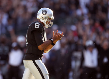 OAKLAND, CA - OCTOBER 31:  Jason Campbell #8 of the Oakland Raiders claps his hands after the Raiders scored their last touchdown against the Seattle Seahawks at Oakland-Alameda County Coliseum on October 31, 2010 in Oakland, California.  (Photo by Ezra S