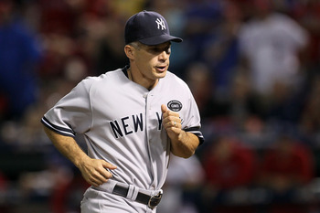 ARLINGTON, TX - OCTOBER 22:  Manager Joe Girardi of the New York Yankees runs on the field in Game Six of the ALCS against the Texas Rangers during the 2010 MLB Playoffs at Rangers Ballpark in Arlington on October 22, 2010 in Arlington, Texas.  (Photo by