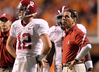 KNOXVILLE, TN - OCTOBER 23: Greg McElroy #12 and Nick Saban the Head Coach of the Alabama Crimson Tide are pictured during a timeout in the SEC game against the Tennessee Volunteers at Neyland Stadium on October 23, 2010 in Knoxville, Tennessee.  (Photo b
