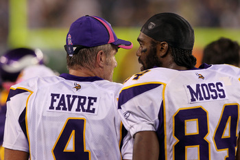 EAST RUTHERFORD, NJ - OCTOBER 11:  (L-R) Brett Favre #4 and Randy Moss #84 of the Minnesota Vikings talk on the sideline against the New York Jets at New Meadowlands Stadium on October 11, 2010 in East Rutherford, New Jersey.  (Photo by Jim McIsaac/Getty