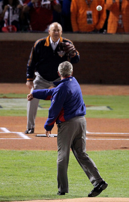 ARLINGTON, TX - OCTOBER 31:  Former President of the United States, George W. Bush, throws out the ceremonial first pitch to former MLB pitcher, Nolan Ryan, before the Texas Rangers host the San Francisco Giants in  in Game Four of the 2010 MLB World Seri