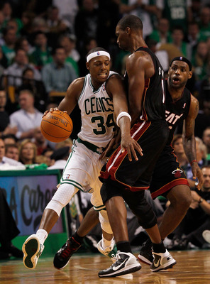 BOSTON, MA - OCTOBER 26:  Paul Pierce #34 of the Boston Celtics drives around Chris Bosh #1 and LeBron James #6 of the Miami Heat during a game against the Miami Heat at the TD Banknorth Garden on October 26, 2010 in Boston, Massachusetts. NOTE TO USER: U