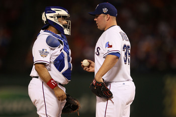 ARLINGTON, TX - OCTOBER 31:  (L-R) Bengie Molina #11 of the Texas Rangers talks with starting pitcher Tommy Hunter #35 against the San Francisco Giants in Game Four of the 2010 MLB World Series at Rangers Ballpark in Arlington on October 31, 2010 in Arlin
