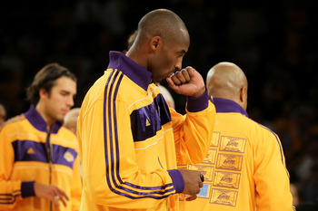 LOS ANGELES, CA - OCTOBER 26:  Kobe Bryant #24 of the Los Angeles Lakers kisses his 2009-2010 Championship Ring after the Lakers were given the rings during a ceremony prior to their opening night game against the Houston Rockets at Staples Center on Octo