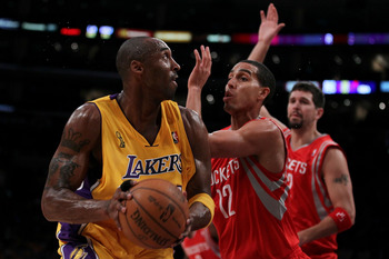LOS ANGELES, CA - OCTOBER 26:  Kobe Bryant #24 of the Los Angeles Lakers looks to move the ball against Kevin Martin #12 of the Houston Rockets during their opening night game at Staples Center on October 26, 2010 in Los Angeles, California. NOTE TO USER: