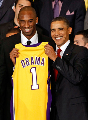 WASHINGTON - JANUARY 25:  President Barack Obama (R) poses for photographs with Kobe Bryant (L) and members of the National Basketball Association 2009 champions Los Angeles Lakers in the East Room of the White House January 25, 2010 in Washington, DC.  T