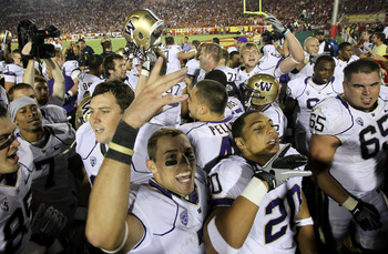 LOS ANGELES, CA - OCTOBER 02:  The Washington Huskies celebrate after the game with the USC Trojans at the Los Angeles Memorial Coliseum on October 2, 2010 in Los Angeles, California.  Washington won 32-31.  (Photo by Stephen Dunn/Getty Images)