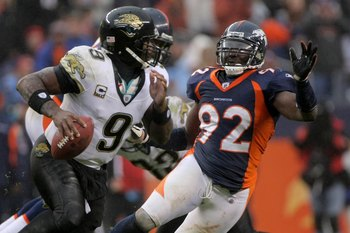 DENVER - OCTOBER 12:  Defensive end  Elvis Dumervil #92 of the Denver Broncos pressures quarterback David Garrard #9 of the Jacksonville Jaguars during NFL action at Invesco Field at Mile High on October 12, 2008 in Denver, Colorado. The Jaguars defeated 