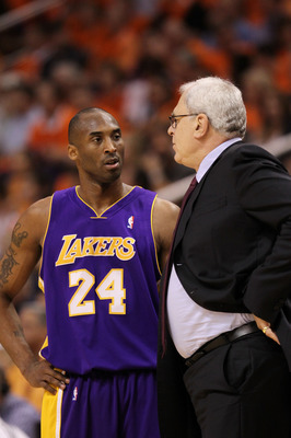 PHOENIX - MAY 29:  Kobe Bryant #24 and head coach Phil Jackson of the Los Angeles Lakers talk in the first quarter of Game Six of the Western Conference Finals against the Phoenix Suns during the 2010 NBA Playoffs at US Airways Center on May 29, 2010 in P