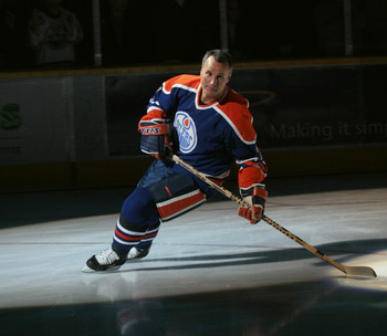 EDMONTON, CANADA - OCTOBER 18:  Edmonton Oiler great Paul Coffey takes a final skate around the ice after his number 7 banner was raised to the rafters during a special ceremony before the game against the Phoenix Coyotes on October 18, 2005 at Rexall Pla