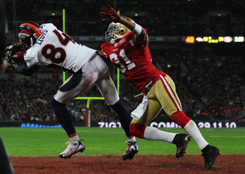 LONDON, ENGLAND - OCTOBER 31:  Brandon Lloyd #84 of Denver Broncos beats William James #31 of San Francisco 49ers to the ball as he scores their second touchdown during the NFL International Series match between Denver Broncos and San Francisco 49ers at W