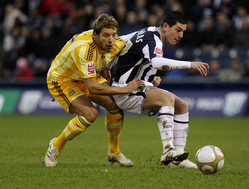 WEST BROMWICH, ENGLAND - JANUARY 23:    Graham Dorrans of West Bromwich Albion tangles with Alan Smith of Newcastle United during the FA Cup sponsored by E.O.N 4th Round match between West Bromwich Albion and Newcastle United at The Hawthorns on January 2