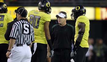 EUGENE, OR - OCTOBER 21:  Head Coach Chip Kelly of the Oregon Ducks talks to players duringa atimeout agaist  the UCLA Bruins  on October 21, 2010 at the Autzen Stadium in Eugene, Oregon.  (Photo by Jonathan Ferrey/Getty Images)