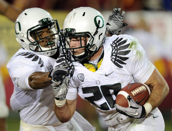 LOS ANGELES, CA - OCTOBER 30:  John Boyett #20 of the Oregon Ducks reacts to his interception with Eddie Pleasant on their way to a 53-32 win over the USC Trojans at Los Angeles Memorial Coliseum on October 30, 2010 in Los Angeles, California.  (Photo by