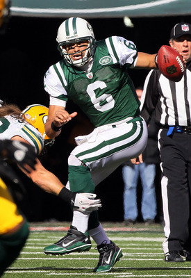 EAST RUTHERFORD, NJ - OCTOBER 31: Mark Sanchez #6 of the New York Jets scrambles against the Green Bay Packers on October 31, 2010 at the New Meadowlands Stadium in East Rutherford, New Jersey. (Photo by Jim McIsaac/Getty Images)