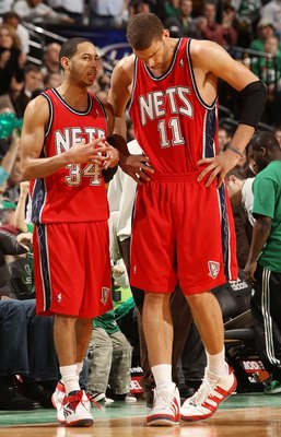 BOSTON - FEBRUARY 27:  Devin Harris #34 of the New Jersey Nets talks with Brook Lopez #11 during a time out against the Boston Celtics at the TD Garden on February 27, 2010 in Boston, Massachusetts. The Nets defeated the Celtics 104-96.  NOTE TO USER: Use