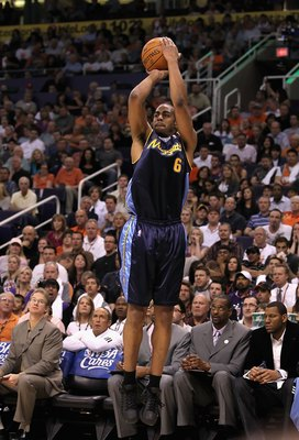 PHOENIX - APRIL 13:  Arron Afflalo #6 of the Denver Nuggets puts up a shot during the NBA game against the Phoenix Suns at US Airways Center on April 13, 2010 in Phoenix, Arizona. The Suns defeated the Nuggets 123-101.  NOTE TO USER: User expressly acknow