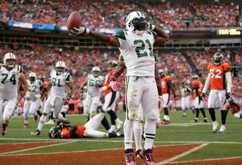 DENVER - OCTOBER 17:  Running back LaDainian Tomlinson #21 of the New York Jets celebrates his touchdown against the Denver Broncos at INVESCO Field at Mile High on October 17, 2010 in Denver, Colorado.  (Photo by Justin Edmonds/Getty Images)
