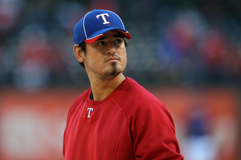 ARLINGTON, TX - OCTOBER 15:  Jorge Cantu #8 of the Texas Rangers looks on during batting practice against the New York Yankees in Game One of the ALCS during the 2010 MLB Playoffs at Rangers Ballpark in Arlington on October 15, 2010 in Arlington, Texas.