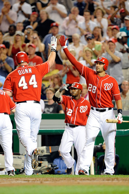 WASHINGTON - SEPTEMBER 24:  Adam Dunn #44 of the Washington Nationals is congratulated by Michael Morse #28 after hitting a home run in the second inning against the Atlanta Braves at Nationals Park on September 24, 2010 in Washington, DC.  (Photo by Greg