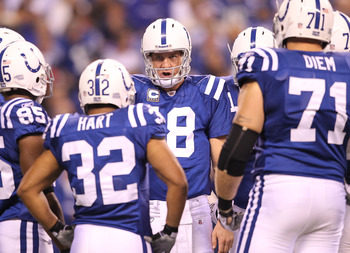 INDIANAPOLIS - NOVEMBER 01:  Peyton Manning #18 of Indianapolis Colts gives instructions to his team in the hudlle during the NFL game against the Houston Texans  at Lucas Oil Stadium on November 1, 2010 in Indianapolis, Indiana.  (Photo by Andy Lyons/Get
