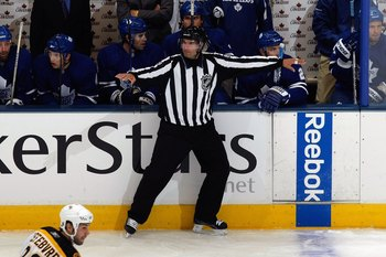 TORONTO - SEPTEMBER 16:  Steve Miller waves off an offside as the Toronto Maple Leafs play against the Boston Bruins during their NHL game at the Air Canada Centre on September 16, 2009 in Toronto, Ontario. (Photo by Dave Sandford/Getty Images)