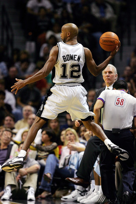 SAN ANTONIO - JANUARY 4:  Forward Bruce Bowen #12 of the San Antonio Spurs throws the ball while falling out of bounds against the Los Angeles Lakers on January 4, 2005 at the SBC Center in San Antonio, Texas.  NOTE TO USER: User expressly acknowledges an