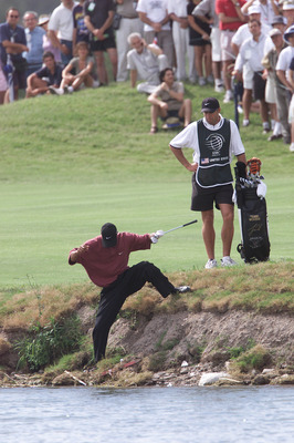10 Dec 2000:  Tiger Woods steps down into a hazard to prepare to hit after partner David Duval's tee shot landed out of bounds on the ninth hole during the final round of the World Cup of Golf at the Buenos Aires Golf Club in Buenos Aires, Argentina.DIGIT