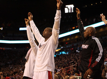 MIAMI - OCTOBER 29:  Guard Dwyane Wade #3 of the Miami Heat celebrates against the Orlando Magic at American Airlines Arena on October 29, 2010 in Miami, Florida.  NOTE TO USER: User expressly acknowledges and agrees that, by downloading and or using this