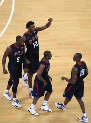 BEIJING - AUGUST 24:  Dwyane Wade #9, Chris Bosh #12 and Chris Paul #13 celebrate with Kobe Bryant #19 of the United States after Bryant made a three point shot in the gold medal game against Spain during Day 16 of the Beijing 2008 Olympic Games at the Be